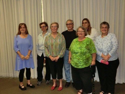 L to R: Colleen Geraghty, first place; Rene Houtrides, second place; Mary Ann Ronconi, third place; David Sylvester, judge; Pam Clements, judge; Nancy Klepsch, judge; Mimi Moriarty, coordinator.
